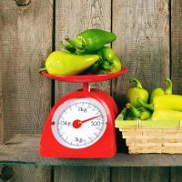 weighing chillies